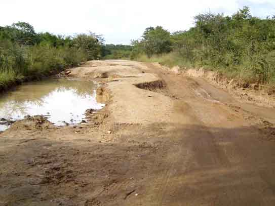 how to fix potholes in dirt road